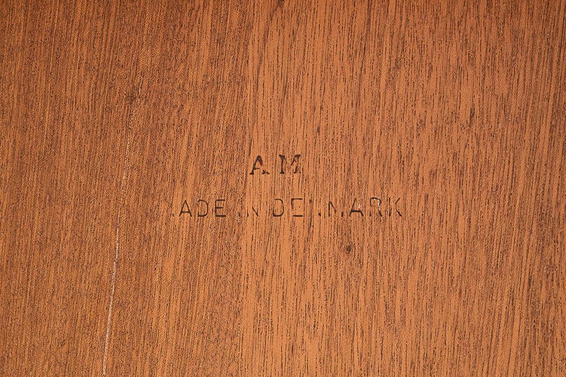 DANISH EXTENDING TEAK TABLE FROM A.M. DENMARK