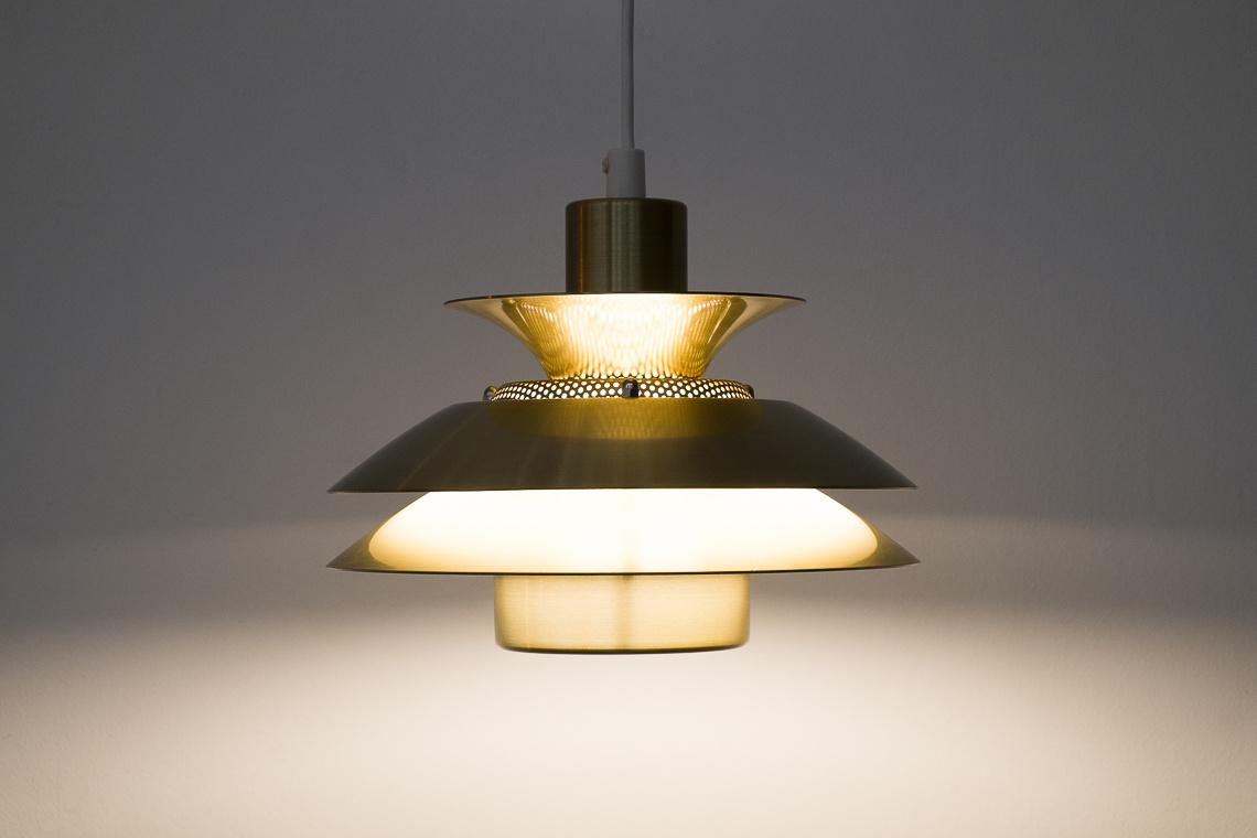 Golden pendant light by Jeka